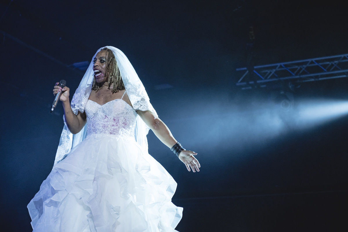 Man in a wedding dress on stage