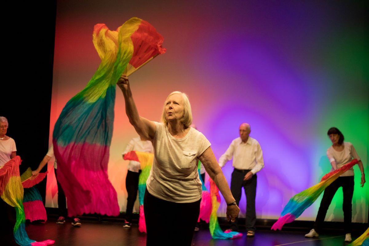 Woman waves a rainbow flag