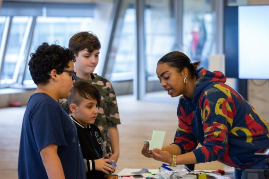 Woman and three children engaged in arts activity